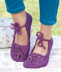Crocheted seamlessly throughout, these ballerina slippers begin at the sole's heel to the toes before cutting the yarn and reattaching it for crocheting the upper section in the round. The crocheted flower is done separately and joined to the slipper in the last round. The ties are the last to be crocheted. Note: The ballerinas widen by about 3/8 to 5/8 inches (1 to 1.5 cm) when first worn.