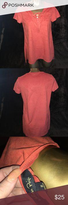 Burnt orange front tie top Burnt orange tie front short sleeve top. Suede like feel. 88% polyester 12% spandex. Size medium NWT melissa paige Tops Blouses