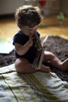 Baby with a book. Super casual easy authentic lifestyle shot.