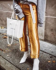 The best pieces to buy at HM right now according to the top fashion bloggers. From vinyl skirts, chunky embellished knits, belt bags and this seasons must have coats & shoes. As seen on the top fashion bloggers from Sindi, Off White Swan, The Fab 3, Lafotka and Constantly K. #FashionBloggers #StreetStyle #Sock #boots #HM #Trousers #whiteboots