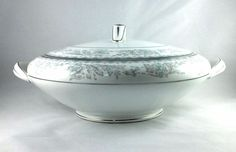 Great Vintage Serving Dish from Noritake, Covered Vegetable dish in the Belmont Pattern.  Discontinued between 1955-1966.  Pattern is done in blue and gray flowers and scrolls.  Platinum lid handle and handles on bowl.  No chips or cracks seen.  10 inches wide from handle to handle, 4 1/2 inches tall from bottom to lid handle.