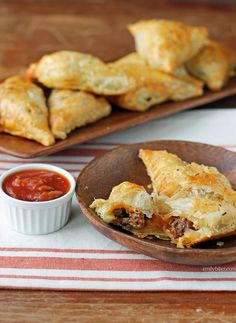 These Taco Puff Pockets are golden flaky pastry layers with seasoned beef and sharp cheddar cheese for just 142 calories or 5 Weight Watchers SmartPoints!