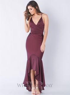 Juliet's Delight Gown. A beautiful hi-low dress by Grace & Hart. Features a V-neck style with ruched retailed on the bust and waistline, and a criss-cross back.