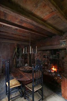 17th century chairs, table, chadelier, cooking fireplace