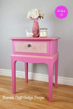 A unique hand painted pretty pink side table with front drawer. Painted with The London Vintage Company sassy unicorn pink and dusky pink chalk paint. With antique white geometric stencil detail on drawer front. Protected in clear wax. A lovely addition to your home. This is a charity piece and I will donate 50% of the sale to breast cancer.