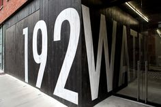 I love the big letters and the way  the street name carries into the inside through the glass.  Great storefront idea!