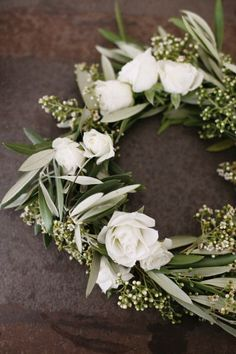 Floral crown of olive, eucalyptus seed pods and white roses.