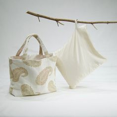 Large corn bag with ivory cover and gold paisley fabric tote