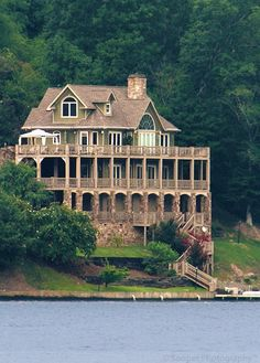 Places I'd like to LIVE...lake house...maybe not so HUGE...but I like the yard and the little walkway to the lake...I could do without 2 of the levels though...