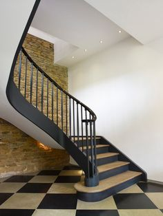 The Barns.  Cantilevered staircase to main bedroom. Chequerboard floor of grey limestone and Belgian black stone.