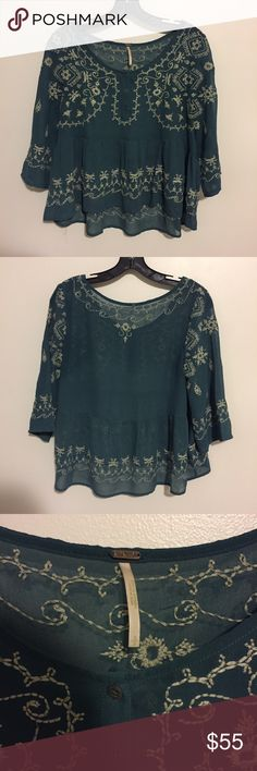 Free people embroidered chiffon blouse Bask in breezy bohemian style with the Free People Pennies top--eclectic embroidery and an airy silhouette are rustic musts. Polyester Machine Wash Imported Round neck, three quarter sleeves, partial button placket, pleated. Excellent condition. Front top to bottom length 20.5in / back top to bottom length 23in / armpit to armpit 18.25in. 100% Polyester. Its a chiffon blouse its sheer and thin material. Size is small. Free People Tops Blouses