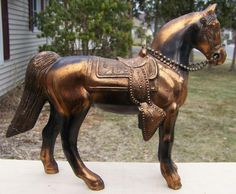 OMG, these metal carnival prize horses from 1960s-70s! I had several of these on my bedroom shelves growing up.  I always won some of these every year when the carnival was in town. oh, the memories