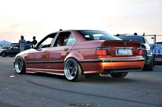 BMW e36 sedan with different colour choice on cult classic AC Schnitzer type 1 wheels