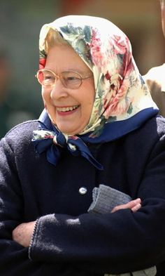 We love this floral scarf so much we're giving it a place on our hat roster! The Queen covered her curls in style while watching the Royal Windsor Horse Show. Photo: Getty Images