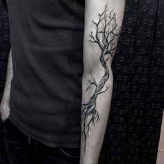 Gentleman With Tree Winding Tree Branches Forearm Tattoo