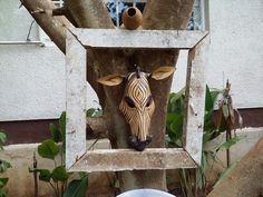 Zebra mask in old wood photo frame