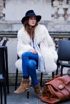 bold fur coat, cowboy hat & bright blue jeans. love this look!