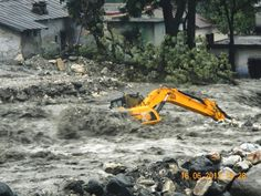 Bulldozer washed away in flood waters in Uttarakhand, India, June 2013 Posted by floodlist.com