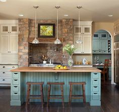rustic kitchen featuring a turquoise island...