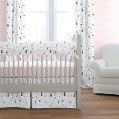 Pink and Navy Baby Woodland Crib Bedding by Carousel Designs.