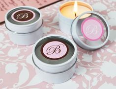 """Monogram Round Travel Candle Tins. Coming up with a theme for your wedding reception or bridal shower can be difficult at best, but you needn't waste hour after hour on it. Rather, all you need is something simple and elegant to complement your favorite colors. Just adding a simple monogram initial can make a bold impact. Monograms provide an understated elegance and can be the """"theme"""" that you're looking for. Our Monogram Round Travel Candle Tins make the perfect addition to..."""