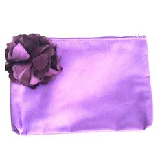 Tarte purple cosmetics bag with flower pinned on. Tarte purple cosmetics bag with flower pinned on. Nwot! Can be used as a clutch as well. Sephora Bags Cosmetic Bags & Cases