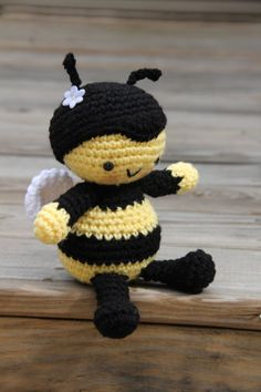 Crocheted stuffed Amigurumi Bee is handmade in soft acrylic yarn in a cheery yellow and black striped pattern with white bumble wings and those