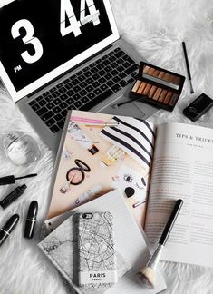 Flatlay macbook, magazine, eyeshadow, notebook, iphone