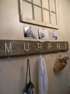 Photos of my beautiful newborn by BeesKnees and Bellasaluti, both in Minneapolis.  Anthro letter hooks on antique barn beam.