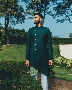 The talented, Tejeshwar Sandhoo certainly emerges with extreme sharpness in the Forest Green Sherwani with asymmetric… Sherwani For Men Wedding, Wedding Dresses Men Indian, Sherwani Groom, Wedding Dress Prices, Wedding Dress Men, Sikh Wedding, Wedding Men, Sabyasachi