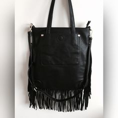NWOT Black Fringe Purse Fringe purses are all the rage for this spring!Excellent new condition... Adorable and stylish. Has two small straps so it can be carried on the arm, also has one long strap so that you can carry purse as a crossbody bag.  awesome purse  Nine West Bags Crossbody Bags