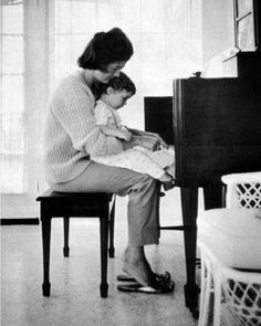 Jackie and Caroline playing the piano, 1959.