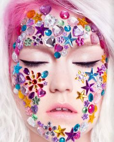 week 13- Images of makeup with rhinestones I like that this image is almost full face rhinestone coverage with lots of different colors.
