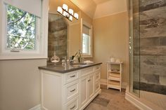 Love the painted, white vanity with the grey countertop.