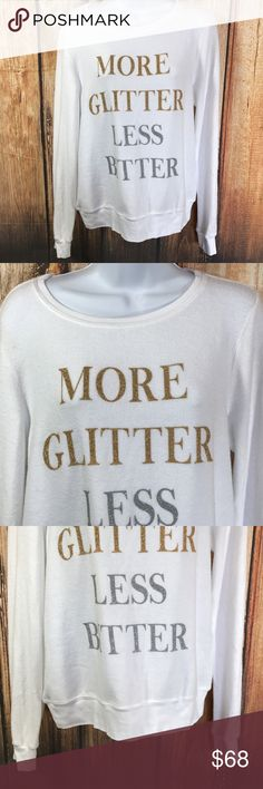 "Wildfox More Glitter Less Bitter Sweatshirt NEW Wildfox  More Glitter Less Bitter  Super soft sherpa fleece sweatshirt  Size Small  Measures about 19"" across bust  Measures about  21.5"" long from center back  Sleeves measure about  24.5 long from shoulder seam to cuff hem  NEW, no tags Wildfox Tops Sweatshirts & Hoodies"