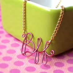 Think I'll be doing one of these with my monogram...gold chain and silver letters