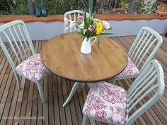 Beautifully redone table and chairs. Love the color combo.