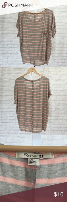 F21 Stripped Shirt Cute grey and pink loose shirt. Great with leggings and jeans. The material is soft and it is in good condition. Forever 21 Tops Tees - Short Sleeve