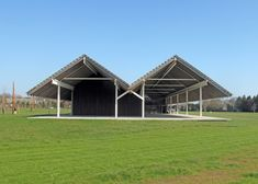 This may look like a pair of barns in a field, but its actually the home that Swiss architecture studio Herzog & de Meuron completed for the Parrish Art Museum on Long Island