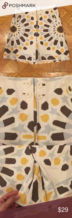Anthro mini skirt by elevanses Cute cotton anthro mini skirt with yellow grey and brown print - 4 buttons and lined. In good worn condition Anthropologie Skirts