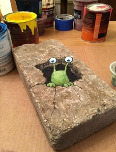 David Zinn, 2015. 'Paint test on micro-sidewalk, confusing Sluggo in the middle of his midwinter nap.'