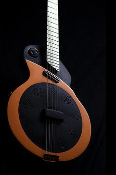 Avante-garde, futuristic, this Alquier guitar looks part resonator. - Shared by The Lewis Hamilton Band - https://www.facebook.com/lewishamiltonband/app_2405167945 - www.lewishamiltonmusic.com http://www.reverbnation.com/lewishamiltonmusic -