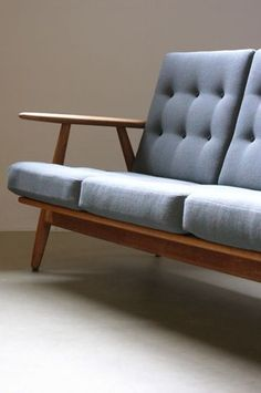 Hans Wegner Cigar Sofa  Fantastic Cigar sofa designed by Hans Wegner for Getama, Denmark. Sculptural solid oak frame with fully reconditioned original sprung cushions with new fabric. Beautiful example.    173W x 75D x 76H