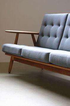 Hans Wegner Cigar Sofa Fantastic Cigar sofa designed by Hans Wegner for Getama, Denmark. Sculptural solid oak frame with fully reconditioned original sprung cushions with new fabric. Beautiful example. 173W x 75D x 76H
