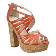 """Platform cork sandal with leather upper. Adjustable ankle strap buckle closure. Measurements: heel 5 1/4"""" and platform 1.5."""""""