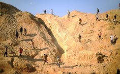 Miners scramble up the walls of an open-cast sapphire mine, near the Ilakaka, Madagascar at the end of their shift on September 12, 2008. (ROBERTO SCHMIDT/AFP/Getty Images) #