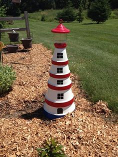 Cute lighthouse made with terra cotta pots!