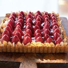 Prepare the crust and filling up to 2 days ahead for this strawberry-almond cream tart; then assemble the dessert recipe the morning of your brunch. You'll have extra glaze--try it on ice cream or pound cake.