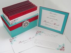 A perfect size, box to display at your wedding and new home as a married couple. This guestbook box and cards is based on a turquoise, red and white theme with a vintage rhinestone brooch.