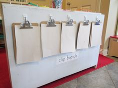 "More than just a bookshelf by Teach Preschool - clipboards on the back ("",)"